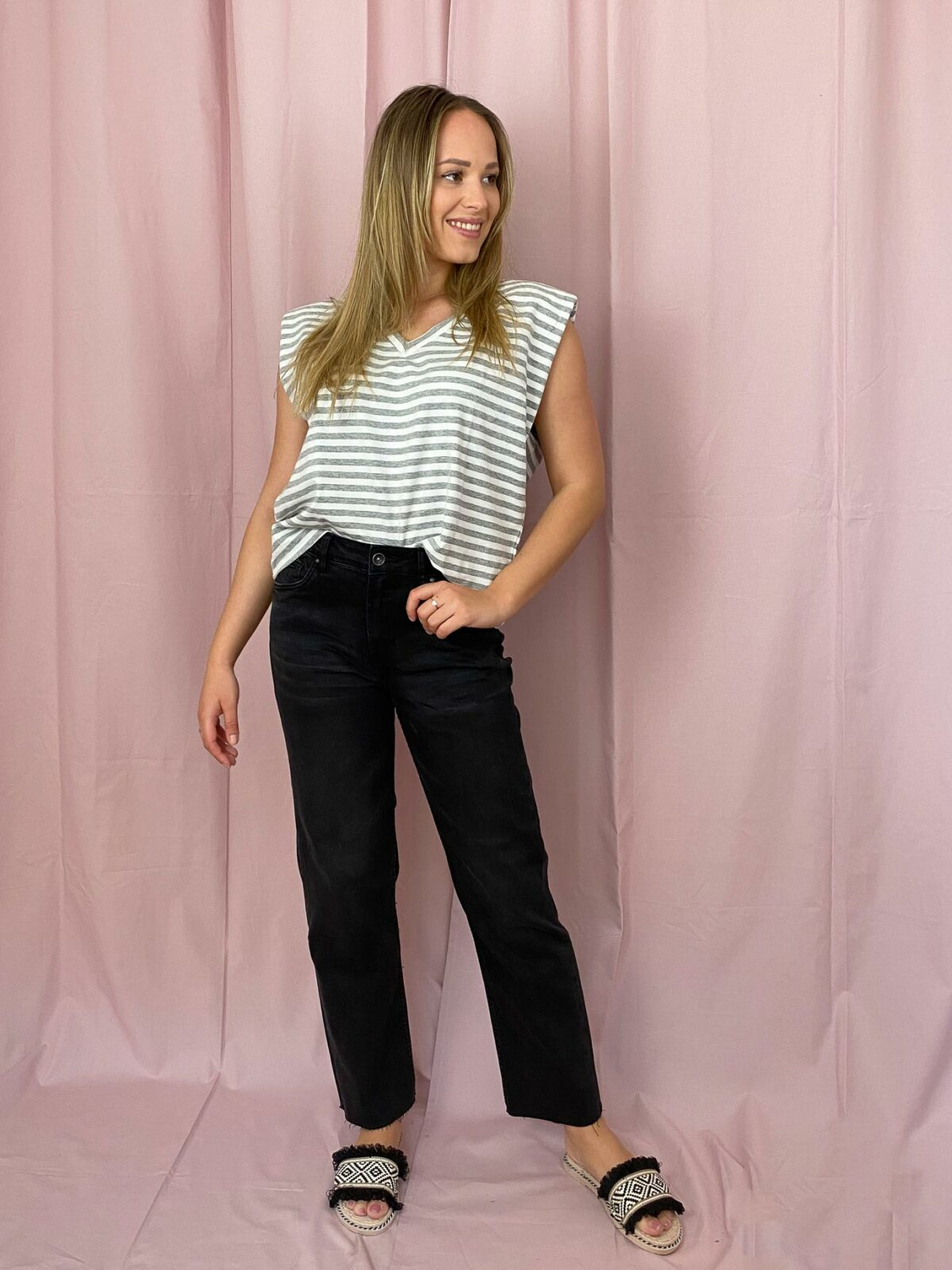 woman with a striped top and black denim pants