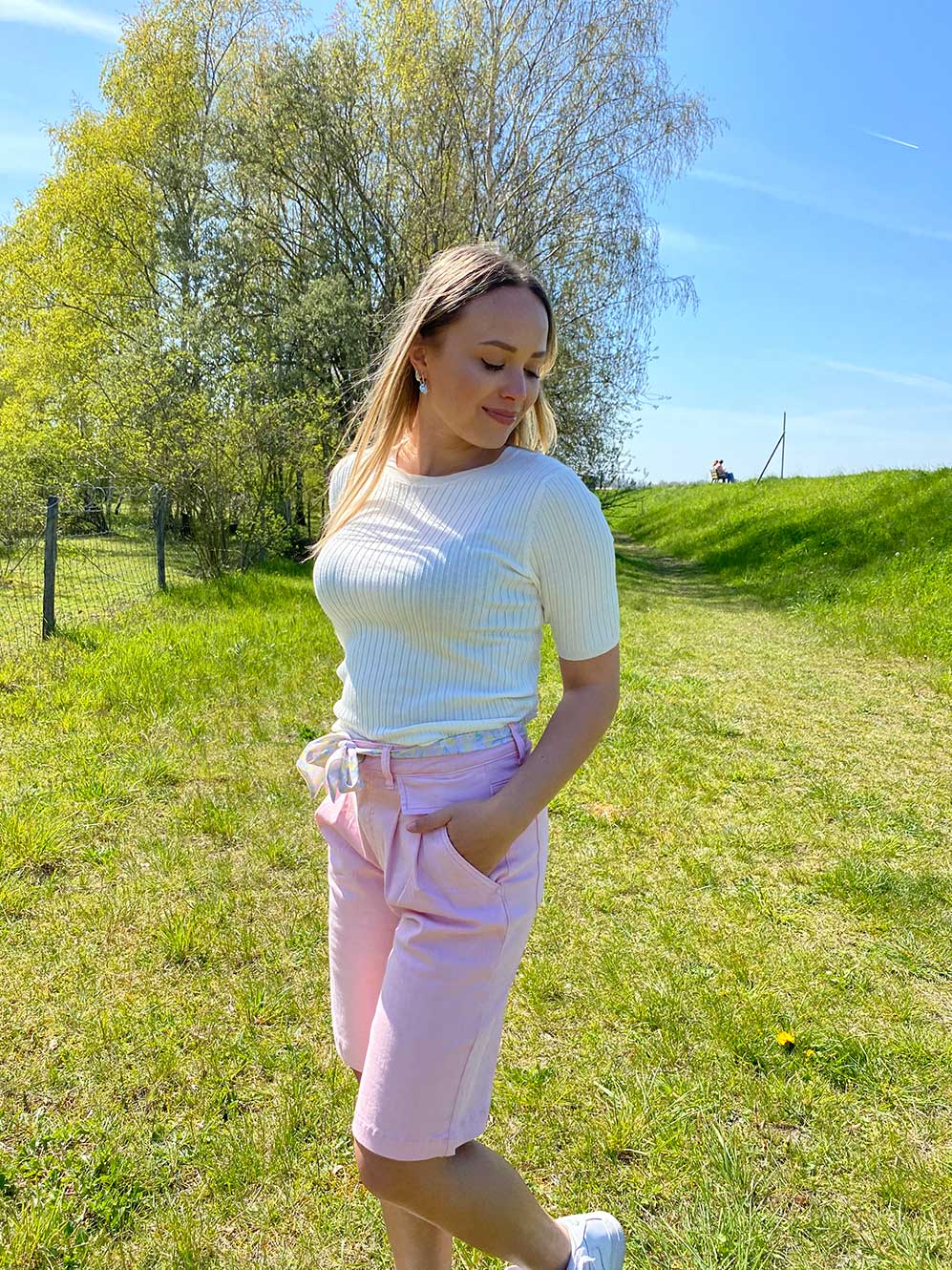 woman with a white tshirt and light pink shorts