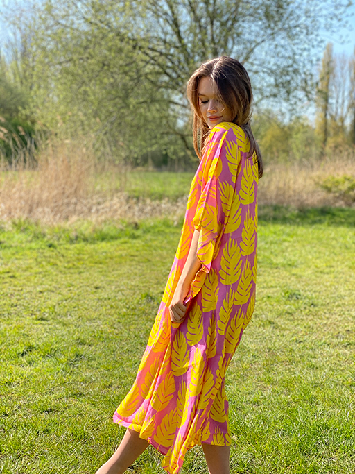 woman with a yellow and pink kaftan dress