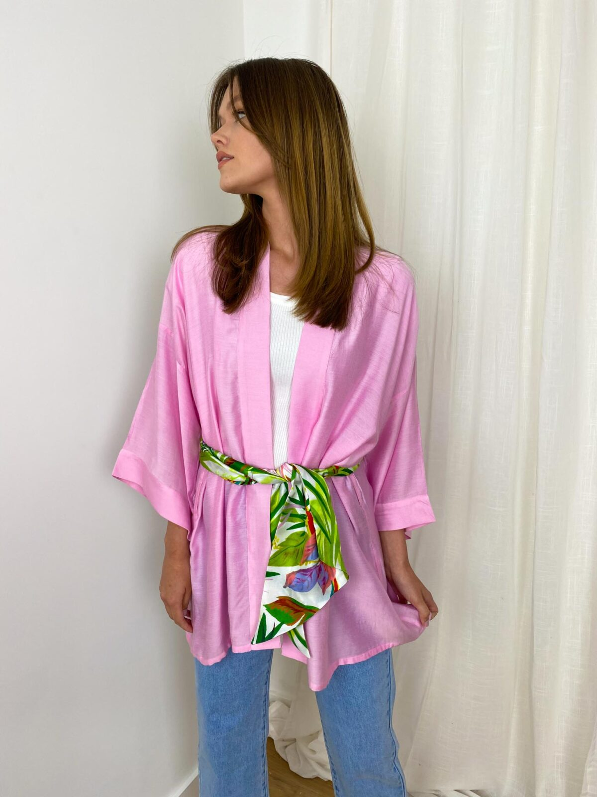 woman with a pink kimono and a green ribbon