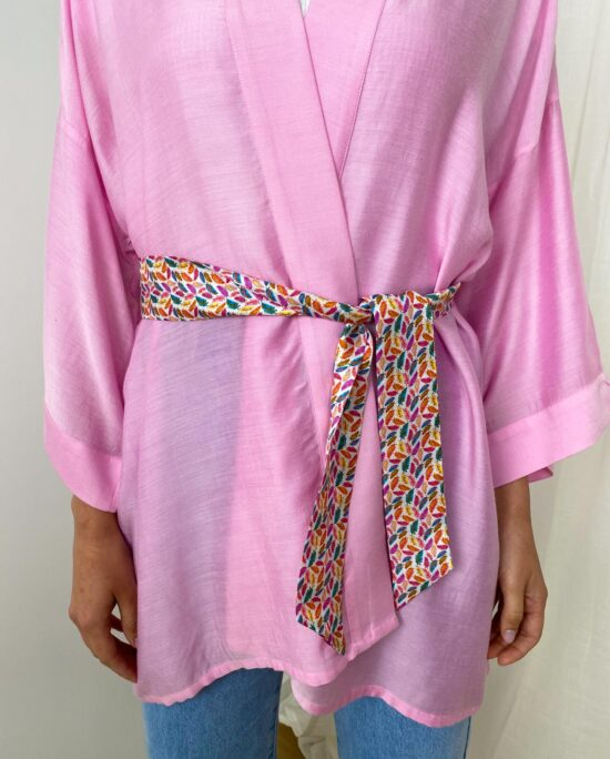 woman with a pink kimono and a ribbon