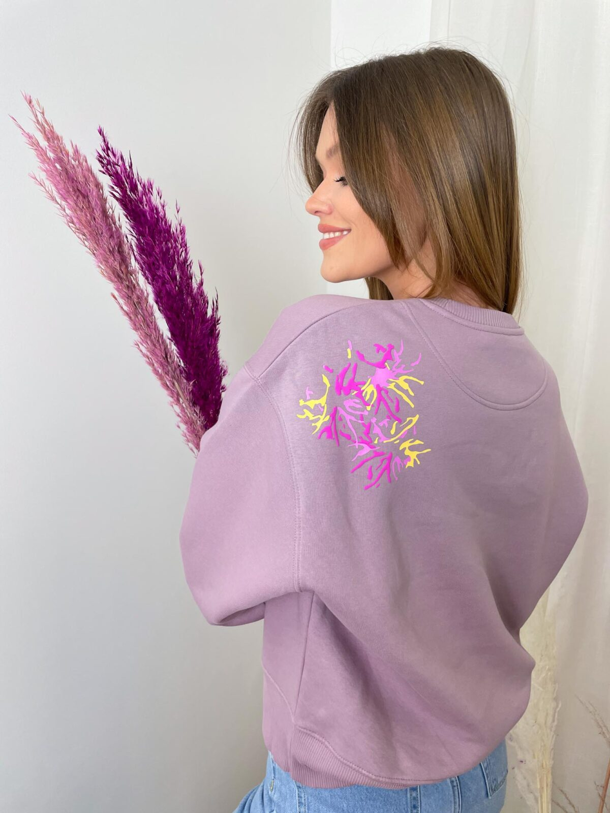 woman with a lilac sweater