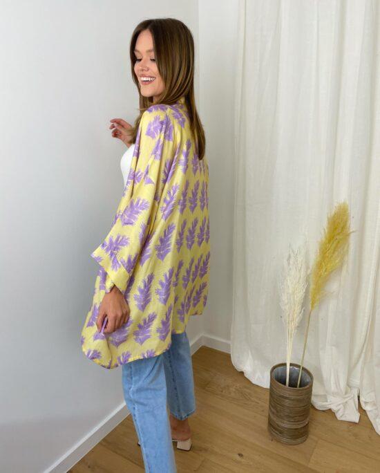 woman with a yellow kimono and denim pants