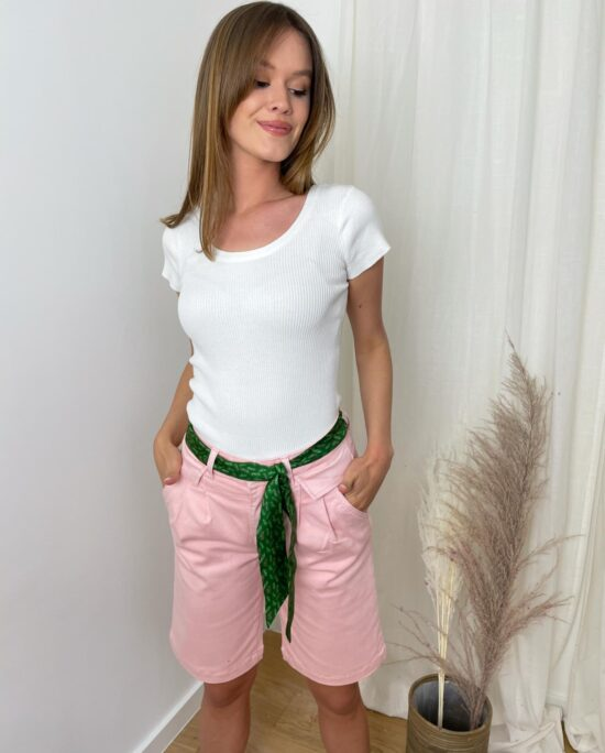 woman with pinks shorts and a white tshirt