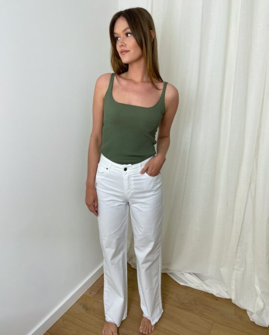 woman with white denim pants and a khaki top