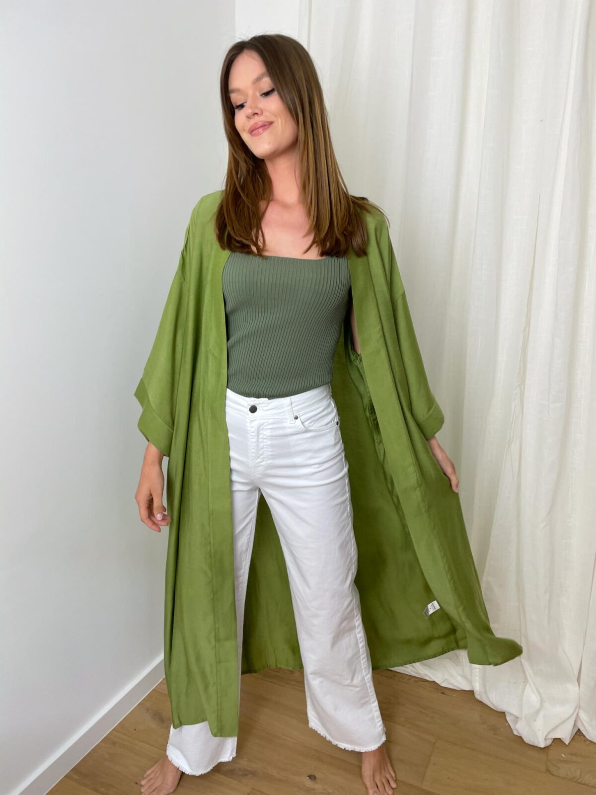 woman with a kaki kimono and white denim pants
