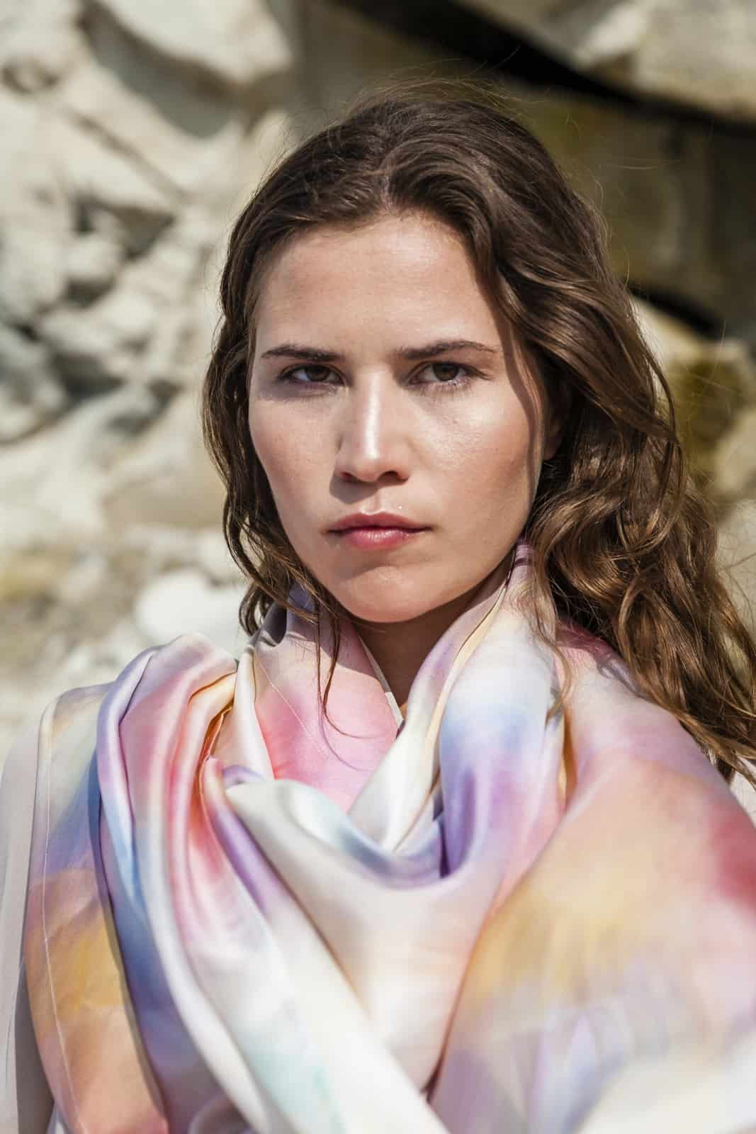 woman with a satin colourful scarf on her neck