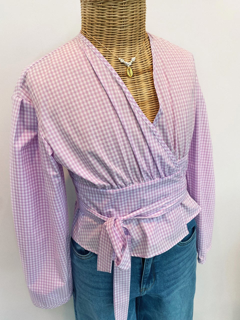 fitting doll with a lilac checked top and denim pants
