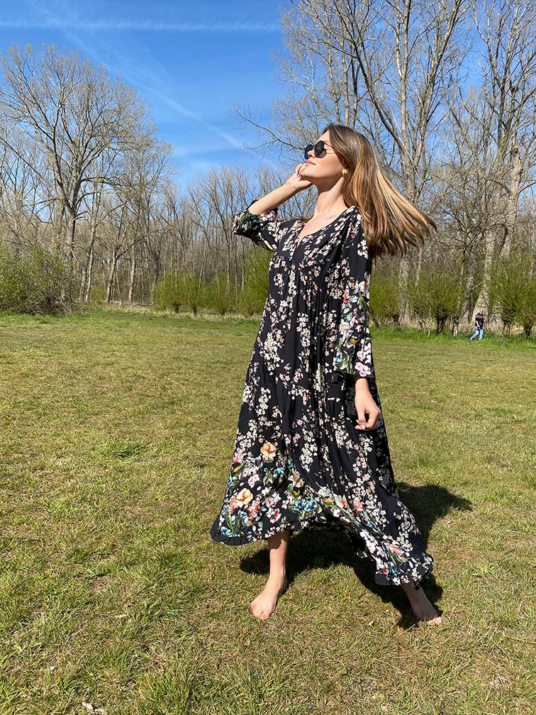 woman with a black flower dress in the park