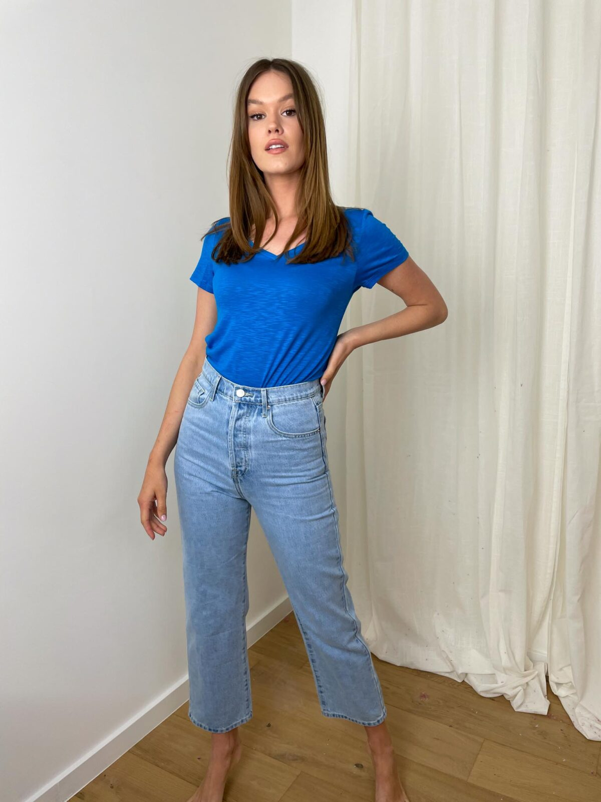 woman with a blue tshirt and denim pants