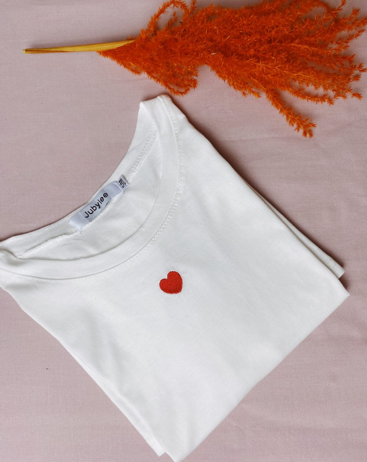 white tshirt with a red heart