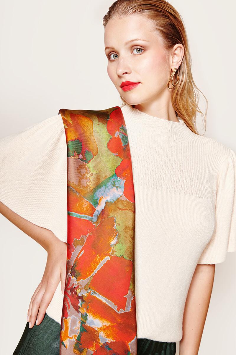 woman wearing the carre orange flower scarf.