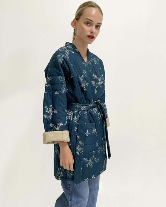 woman wearing quilted kimono coffee bean blue