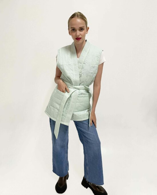 quilted sleeveless jacket mint on a jeans and tshirt